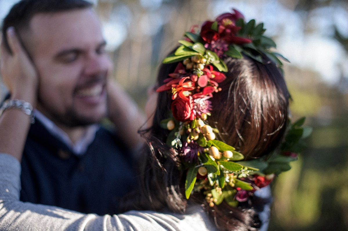 man and woman with flower crown