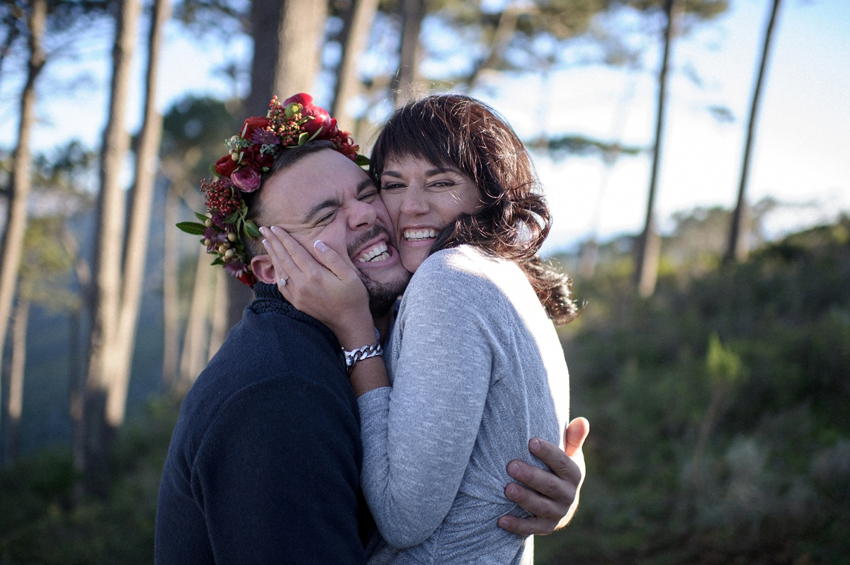 woman embracing man with flower crown